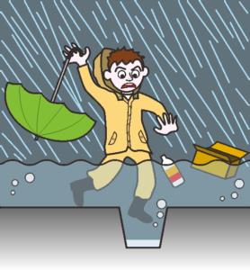 大雨で道路が冠水しているため、側溝に片足を落としそうになっている男性。