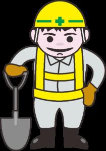 スコップを持った工事作業員