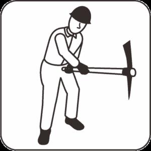 ツルハシを使う建設作業員