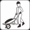 一輪車で建材を運ぶ作業員